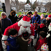 11/28/09 -- BATH, Maine. Santa greets assembled children and adults at Bath's Gazebo on Saturday afternoon. Santa had planned to hit Brunswick first on Friday, but due to heavy rain, he went to Bath first and then returned to Brunswick on Sunday. Photo by Roger S. Duncan.
