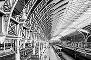 EDITORS NOTE: Image has been converted to black and white. Londons Paddington Station, a major rail hub, is deserted due to lockdown as a result of the Coronavirus Pandemic on 16th April 2020 in London, United Kingdom. Coronavirus or Covid-19 is a new respiratory illness that has not previously been seen in humans. Much of Europe has been placed into lockdown, with stringent rules in place as part of a long term strategy, and in particular social distancing, and a stay at home policy.