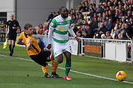 Newport's Scot Bennett slide tackles Yeovil's Francois Zoko. Skybet football league two match, Newport county v Yeovil Town at Rodney Parade in Newport, South Wales on Saturday 21st November 2015.<br /> pic by David Richards, Andrew Orchard sports photography.