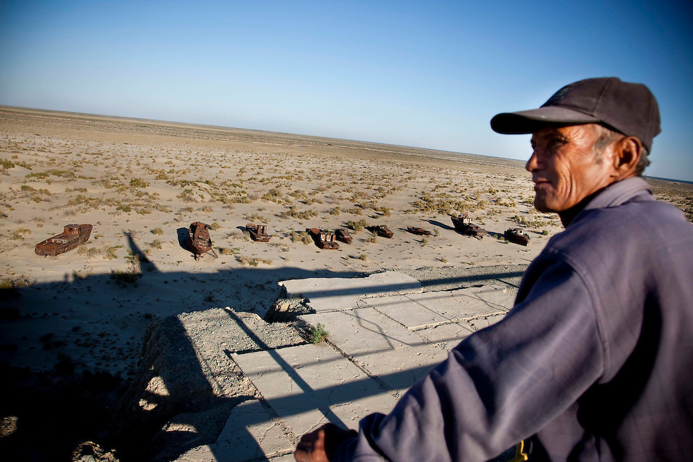 A fomer captain of a fishing boat watches the Aral Sea in silence. The Aral Sea has gone from its initial shores to 150-170 km.