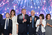 GOP Presidential candidate Donald Trump and running mate Gov. Mike Pence and their families stand on stage as balloons and confetti drop after accepting the party nomination for president on the final day of the Republican National Convention July 21, 2016 in Cleveland, Ohio.