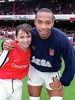 Thierry Henry with the Arsenal mascot before the match. Arsenal v Manchester City, F.A.Carling Premiership, 28/10/2000. Credit Colorsport / Stuart MacFarlane.