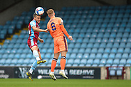 Bournemouth loanee Frank Vincent (23) of Scunthorpe United battles for possession with Callum Guy of Carlisle United during the EFL Sky Bet League 2 match between Scunthorpe United and Carlisle United at Glanford Park, Scunthorpe, England on 26 September 2020.