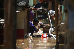 February 6, 2018 - Jakarta, Capital Region of Jakarta, Indonesia - Residents activity in the midst of floods that hit a number of areas in Jakarta on Tuesday, February 6, 2018. Heavy rains that occurred last few days, causing a number of areas in the capital flooded with a water range of 50-200 cm. Heavy rains that occurred over the past few days, caused a number of areas in the capital flooded with high altitude water ranges from 50-200 cm. (Credit Image: © Aditya Irawan/NurPhoto via ZUMA Press)