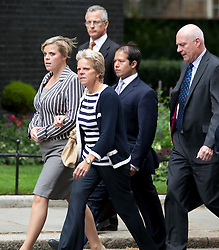 © Licensed to London News Pictures. File picture dated 13/07/11. The family of murder victim Milly Dowler (L sister Gemma, C mother Sally and far R father Bob) walk on Downing Street to meet with the Prime Minister David Cameron to discuss the News of the World hacking allegations as part of the 'Hacked Off' campaign. Milly Dowler's Killer,  Levis Belfield, has confessed further details of how he tortured, raped and killed the teenager. . Photo credit: Matt Cetti-Roberts/LNP