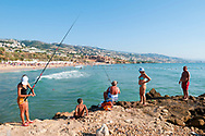 Byblos, Lebanon - September 4, 2010: Women fish in the Mediterranean Sea on a late summer afternoon in Byblos (Jbeil), Lebanon.