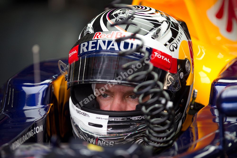 Sebastian Vettel (Red Bull-Renault) in the garage with helmet on before the 2012 Malaysian Grand Prix in Sepang outside Kuala Lumpur. Photo: Grand Prix Photo