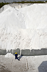Inspector Guido De Rycke looks over the mounds of salt used to make chlorine, at the Solvay SA chemical plant in Antwerp, Belgium, on Thursday, April 22, 2010.  Solvay SA is the world's largest supplier of Soda Ash or Sodium Carbonate and is also a major producer of caustic soda, hydrogen peroxide, chlorine and fluorinated products. (Photo © Jock Fistick)
