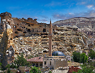 Pictures & images of the cave town houses in the rock formations of Cavusin, near Goreme, Cappadocia, Nevsehir, Turkey .<br /> <br /> If you prefer to buy from our ALAMY PHOTO LIBRARY  Collection visit : https://www.alamy.com/portfolio/paul-williams-funkystock/cappadociaturkey.html (TIP refine search - type which part of Cappadocia into the LOWER search box)<br /> <br /> Visit our TURKEY PHOTO COLLECTIONS for more photos to download or buy as wall art prints https://funkystock.photoshelter.com/gallery-collection/3f-Pictures-of-Turkey-Turkey-Photos-Images-Fotos/C0000U.hJWkZxAbg