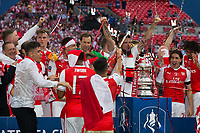 Arsenal players celebrate with the trophy        <br /> <br /> <br /> Photographer Craig Mercer/CameraSport<br /> <br /> The Emirates FA Cup Final - Arsenal v Chelsea - Saturday 27th May 2017 - Wembley Stadium - London<br />  <br /> World Copyright © 2017 CameraSport. All rights reserved. 43 Linden Ave. Countesthorpe. Leicester. England. LE8 5PG - Tel: +44 (0) 116 277 4147 - admin@camerasport.com - www.camerasport.com