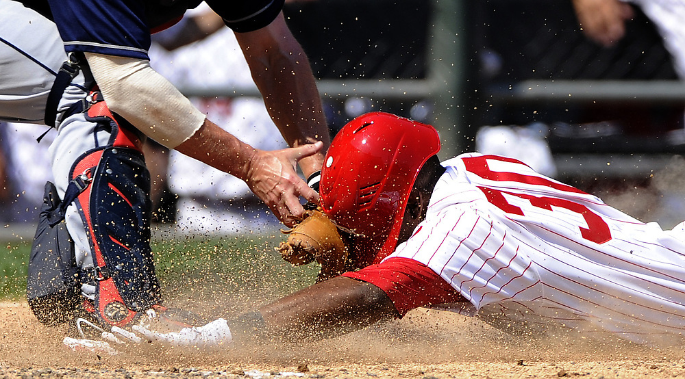 CHICAGO, IL - MAY 26:  Lou Marson #6  of the Cleveland Indians tags out Alejandro De Aza #30 of the Chicago White Sox as De Aza tried to stretch his triple and score in the fifth inning on Sunday, May 27, 2012 at U.S. Cellular Field in Chicago, Illinois. (Photo by Ron Vesely)