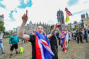 People participate in a protest called by a far-right group Hearts of Oak in Parliament Square in London, on Saturday, August 1, 2020. (VXP Photo/ Vudi Xhymshiti)