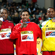 Gold medal winner Abdalaati Iguider of Morocco, center, is flanked by Turkish silver medallist Ilham Tanui Ozbilen, left, and bronze medal winner Mekonnen Gebremedhin of Ethiopia  during the IAAF World Indoor Championships at the Atakoy Athletics Arena, Istanbul, Turkey. Photo by TURKPIX