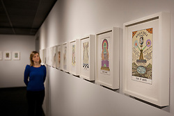 © licensed to London News Pictures. London, UK 06/03/2012. A woman looks at Suzanne Treister's Hexen 2.0 exhibition. Treister applies new subjects and suggestions to the tarot format in her new exhibition at Science Museum, London. Photo credit: Tolga Akmen/LNP