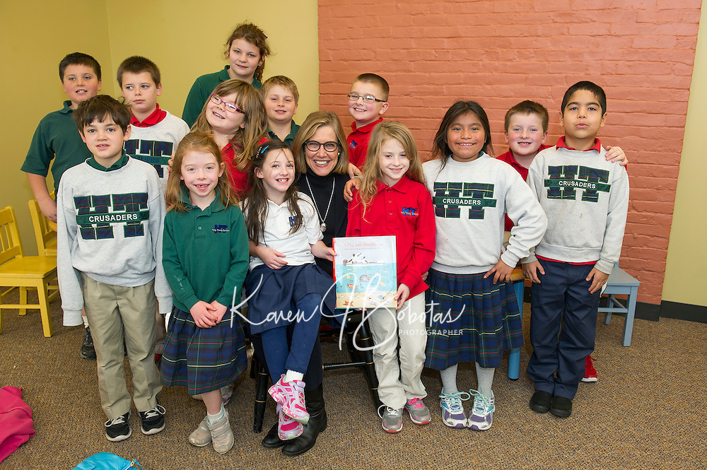 """Author Elizabeth Howard sits with Mrs. Gressner's 2nd and 3rd grade students from Holy Trinity School after reading them """"A Day with Bonefish Joe"""" at the Laconia Library Tuesday afternoon.  (Karen Bobotas/for the Laconia Daily Sun)"""