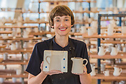 Clare Twomey gets a jug out of a mould - FACTORY: the seen and the unseen - an installation, in the form of a ceramics factory, by artist Clare Twomey. It is set up in the Blavatnik Building of the Tate Modern and launches the second year of Tate Exchange which, over 2017 and 2018, will focus on the theme of production.