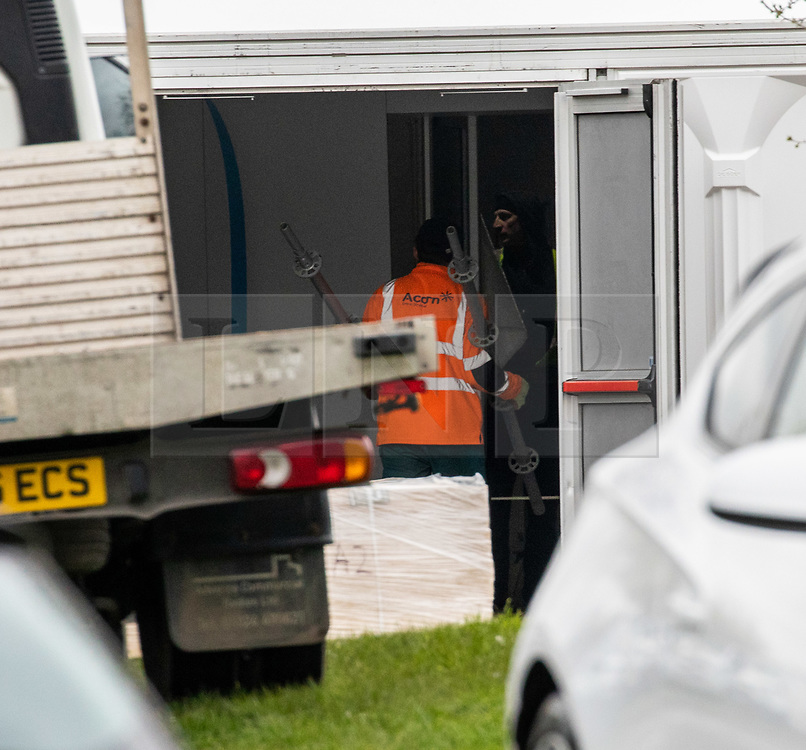 © Licensed to London News Pictures. 30/03/2020. London, UK. Workmen construct new tents which have gone up at Breakspear Crematorium in Ruislip, Hillingdon as Chief aide Dominic Cummings goes into self-isolation after Prime Minister Boris Johnson and Health Secretary Matt Hancock revealed last week that they had contracted coronavirus and are in quarantine as the coronavirus crisis continues. Photo credit: Alex Lentati/LNP