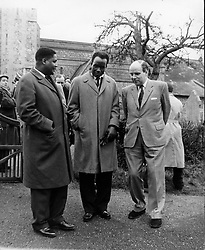 Dec. 12, 1960 - Buckinghamshire, England, U.K. - Minister of Labour IAIN MACLEOD with two delegates of the Rhodesia Conference, Mr. NKOMO andn Mr. KAUNDA after attending a service at the Village Church of Ellesborough. (Credit Image: © Keystone Press Agency/Keystone USA via ZUMAPRESS.com)