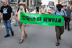 London, UK. 5th June, 2021. Environmental activists from XR Newham join other local residents protesting against the construction of the Silvertown Tunnel. Campaigners opposed to the controversial new £2bn road link across the River Thames from the Tidal Basin Roundabout in Silvertown to Greenwich Peninsula argue that it is incompatible with the UK's climate change commitments because it will attract more traffic and so also increased congestion and air pollution to the most polluted borough of London.