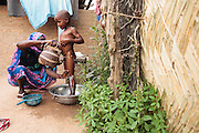 Habsita Moussa, 30, bathes her son Ibrahim, 5, at home in Mongo, Guera province, Chad on Wednesday October 17, 2012.