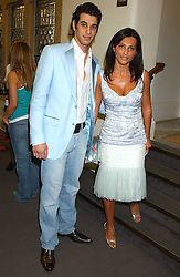 JOHN KRASNER and his mother ELLA KRASNER at a charity event 'In The Pink' a night of music and fashion in aid of the Breast Cancer Haven in association with fashion designer Catherine Walker held at the Cadogan Hall, Sloane Terrace, London on 20th June 2005.<br /><br />NON EXCLUSIVE - WORLD RIGHTS