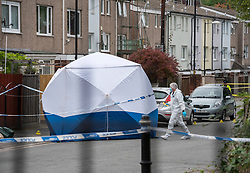 © Licensed to London News Pictures;15/10/2021; Police and forensics with a white tent are seen in Hayes Close in the Newtown area of Lawrence Hill, after police cordoned off a large area around the scene of the murder of a young man last night. A man has been arrested on suspicion of murder and remains in police custody. Photo credit: Simon Chapman/LNP.
