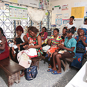 INDIVIDUAL(S) PHOTOGRAPHED: N/A. LOCATION: Epko Abasi Clinic, Calabar, Cross River, Nigeria. CAPTION: The waiting room at the Epko Abasi Clinic is full of beneficiary patients and their babies, who wait to be examined by the doctor and undergo a general health check.