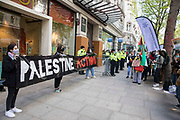 Activists from Palestine Action protest outside the UK headquarters of Elbit Systems, an Israel-based company developing technologies used for military applications including drones, precision guidance, surveillance and intruder-detection systems, on 11th May 2021 in London, United Kingdom. The activists were protesting against the companys presence in the UK and in solidarity with the Palestinian people at a time of a significant rise in tension in Israel and the Occupied Territories following attempts at forced evictions of Palestinian families in the Sheikh Jarrah neighbourhood of East Jerusalem, the deployment of Israeli forces at the Al-Aqsa mosque and the killing of children in Gaza.