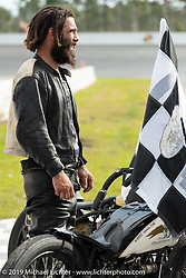 Hobo Billy Applegate after winning his race on Cyclemos number 86 Harley-Davidson in the Sons of Speed Vintage Motorcycle Races at New Smyrina Speedway. New Smyrna Beach, USA. Saturday, March 9, 2019. Photography ©2019 Michael Lichter.