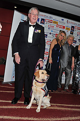 The DUKE OF GLOUCESTER and EJ the dog at the Soldiering On Awards 2013 held at the Park Plaza Hotel, Westminster Bridge, London SE1 on 23rd March 2013.