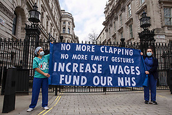© Licensed to London News Pictures. 07/03/2021. London, UK. NHS workers are seen protesting outside Downing Street in central London. They are not accepting proposed by the government 1% pay increase for nurses. Photo credit: Marcin Nowak/LNP