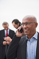 Businessmen busy meeting SMS cell phone Teamwork