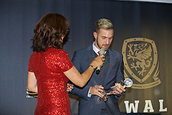 CARDIFF, WALES - Tuesday, November 8, 2016: Wales' Aaron Ramsey with the Euro 2016 Player of the Tournament award during the FAW Awards Dinner at the Vale Resort. (Pic by David Rawcliffe/Propaganda)