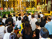 14 DECEMBER 2015 - BANGKOK, THAILAND:   People pray for the Supreme Patriarch in a prayer hall before the start of his funeral at Wat Bowon Niwet in Bangkok. Somdet Phra Nyanasamvara, who headed Thailand's order of Buddhist monks for more than two decades and was known as the Supreme Patriarch, died Oct. 24, 2013, at a hospital in Bangkok. He was 100. He was ordained as a Buddhist monk in 1933 and appointed as the Supreme Patriarch in 1989. He was the spiritual advisor to Bhumibol Adulyadej, the King of Thailand when the King served as a monk in 1956. His funeral, which will take three days,   Dec. 15-17, will be attended by thousands of Thais and most of the Royal Family. Buddhist clergy from around the world are expected to attend.     PHOTO BY JACK KURTZ