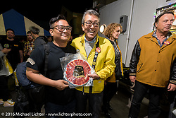 Shige Suganuma after receiving a gift of prosciutto at the Monday night afterparty at Mooneyes Area One after the Mooneyes Yokohama Hot Rod & Custom Show. Yokohama, Japan. December 5, 2016.  Photography ©2016 Michael Lichter.