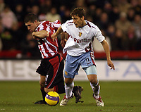 Photo: Paul Thomas.<br /> Sheffield United v Aston Villa. The Barclays Premiership. 11/12/2006.<br /> <br /> Goal scorer Stiliyan Petrov (R) of Villa fights off Nick Montgomery.