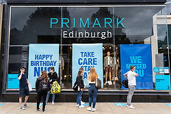 Edinburgh, Scotland, UK. 24 July, 2020. Social distancing in queue outside Primark on Princes Street in Edinburgh. Iain Masterton/Alamy Live News