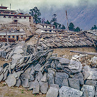 Tibetan Buddhist prayer (mani) stones surround Tengboche Monastery in ithe Khumbu region of Nepal's Himalaya.  Shot in 1974, before the modern onslaught of climbers and trekkers began & this temple burned & was rebuilt more safely.