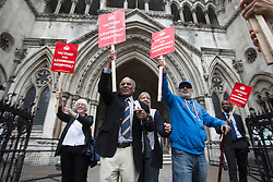 © licensed to London News Pictures. London, UK 31/07/2013. Save Lewisham Hospital Campaigners celebrating as the High Court quashes Health Secretary Jeremy Hunt's downgrade for Lewisham hospital on Wednesday, July 31, 2013. A judge ruled that Mr Hunt acted outside his powers when he announced to Parliament in January that casualty and maternity units at Lewisham Hospital in south-east London would be downgraded. Photo credit: Tolga Akmen/LNP