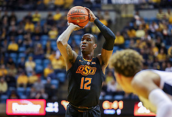 Jan 12, 2019; Morgantown, WV, USA; Oklahoma State Cowboys forward Cameron McGriff (12) shoots a foul shot during the first half against the West Virginia Mountaineers at WVU Coliseum. Mandatory Credit: Ben Queen-USA TODAY Sports