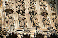 """Medieval Gothic Sculptures of the South portal  of the Cathedral of Chartres, France. The portal shaows the Last Judgement and the small figures represent """"The blessed"""". A UNESCO World Heritage Site."""
