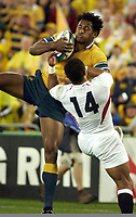 Photo. Steve Holland. England v Australia Final at the Telstra Stadium, Sydney. RWC 2003.<br />22/11/2003.<br />Lote Tuqiri scores the first try as he is tackled by Jason Robinson