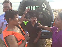 """SHOCKING picture shows emergency personnel save girl after she walked into the sea following an argument with her partner. ..A woman narrowly escaped drowning early this morning after she walked into the sea at Saphan Hin following an argument with her girlfriend...Lt Col Pongpichan Chayanonpiriya of Phuket City Police received reports of the incident at about 6:30am...""""We found a young woman at the scene, crying and calling out for 'Jip'. After searching the area for 30 minutes, rescue workers found the young woman on a broken old boat nearby,"""" said Col Pongpichan...Jip's girlfriend, whose name was withheld by police, said that the two of them had driven up to Saphan Hin and parked nearby to talk. They began arguing, after which Jip got out of the car and ran into the sea...""""Jip, after being rescued, told police that she was very angry with her girlfriend. She had walked about 200 meters from the shore when she got caught in some waves and was swept out. She also said that if it weren't for the boat, she would've ended up dead,"""" said the colonel...She was taken to Vachira Phuket Hospital for treatment..©Phuket News/Exclusivepix Media (Credit Image: © Exclusivepix media via ZUMA Press)"""