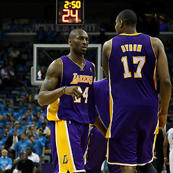 April 28, 2011; New Orleans, LA, USA; Los Angeles Lakers shooting guard Kobe Bryant (24) and center Andrew Bynum (17) during the third quarter in game six of the first round of the 2011 NBA playoffs against the New Orleans Hornets at the New Orleans Arena. The Lakers defeated the Hornets 98-80 to advance to the second round of the playoffs.   Mandatory Credit: Derick E. Hingle