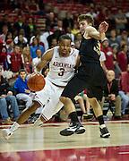 Nov 16, 2011; Fayetteville, AR, USA;  Arkansas Razorbacks guard Rickey Scott (3) drives around Oakland Grizzlies guard Travis Bader (3) during a game at Bud Walton Arena. Arkansas defeated Oakland 91-68. Mandatory Credit: Beth Hall-US PRESSWIRE