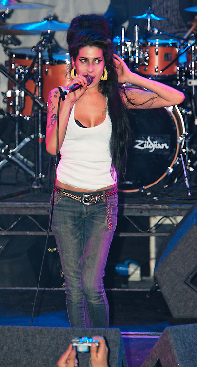 Singer Amy Winehouse, DOB=14/09/1983, performing for her gay fans at the G-A-Y Club. G-A-Y is London's biggest gay club and is held at the London Astoria nightclub, Soho, London, UK. Amy spent much of the show rubbing her itchy nose. She also seemed to have signs of old scars all down one arm...Picture Data:.Photographer: Edward Hirst.Copyright: ©2007 Licensed to Equinox News Pictures +448700 780000.Contact: Equinox Features.Date Taken: 20070415.Time Taken: 014950+0000.www.newspics.com