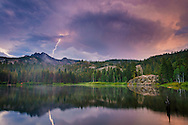 Lightning bolt strikes the Sierra Buttes during evening thunderstorm, Tahoe National Forest, Sierra County, California