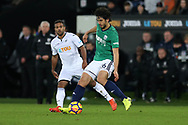 Ahmed Hegazi of West Bromwich Albion gets the ball ahead of Wayne Routledge of Swansea city. Premier league match, Swansea city v West Bromwich Albion at the Liberty Stadium in Swansea, South Wales on Saturday 9th December 2017.<br /> pic by  Andrew Orchard, Andrew Orchard sports photography.