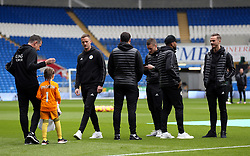 Leicester City's players inspect the pitch before the match