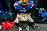 Folsom High School Bulldog's Alan Padilla (11), in the locker room reads the bible before the game as Folsom High School plays Grant High School in the CIF Northern California Regional Division I football championship game at Sacramento State, Friday December 12, 2014.<br /> Brian Baer/Special to the Bee